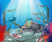 The Mermaid and the Dolphin. The Mermaid swims with her best friend the dolphin in the sea Royalty Free Stock Photo