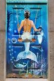 Mermaid and Dolphin. Blue mermaid and dolphin, underwater fantasy scene. Public street art. Madeira stock photo