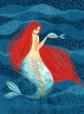 Mermaid with a fish in hand - mythological creature stock illustration