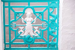 Mermaid gate. Portmeirion mermaid symbol painted white and turquoise Royalty Free Stock Photos