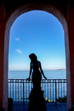 Mermaid Gazing at Pacific Ocean in Archway. Royalty Free Stock Photo