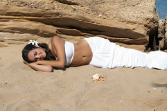 Mermaid. A girl dressed as a mermaid lying on the sand Stock Photography