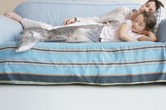 Mermaid Girl And Mother Sleeping On Sofa Stock Photos