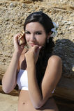 Mermaid. Girl with a seashell to his ear sits on the sand Royalty Free Stock Images