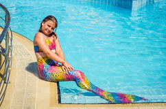 Mermaid girl in tropical swimming pool Stock Image