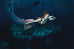Mermaid Girl under the sea. Stock Photo