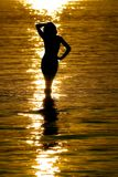 Mermaid and gold. Silhouete during sunset on the river Stock Photo