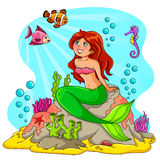 Mermaid and her friends. Mermaid sitting on a rock with happy fish around her Stock Photography