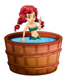 A mermaid inside the big wooden bathtub Royalty Free Stock Photos