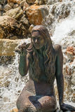 Mermaid. A long haired mermaid holding a butterfly Royalty Free Stock Images