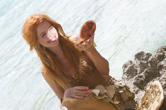 Mermaid looking in mirror Stock Photography