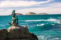 Mermaid of Mazatltan. The famous mermaid statue with chikd that watches over the seaside in Mazatlan, Mexico Stock Photo