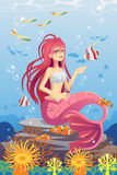 Mermaid in ocean Stock Images
