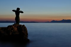 Statue of mermaid in Podgora in evening. Croatia Stock Photos