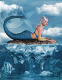 Mermaid on a rock. Beautiful mermaid on a rock Royalty Free Stock Photo
