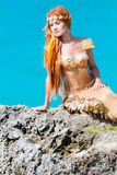 Mermaid on the rock Royalty Free Stock Photo