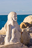Mermaid sculpture carved out of the stone rocks at Piran harbor, Istria Royalty Free Stock Photos