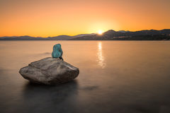 Mermaid sculpture on rock in Ile Rousse Corsica at sunrise Royalty Free Stock Images