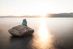 Mermaid sculpture on rock in Ile Rousse Corsica at sunrise Stock Photos