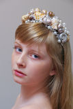 Young blonde girl with seashell hairpiece.  Mermaid crown Stock Images