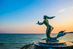 Mermaid statue and children at Sai Kaew beach in Samed island, Rayong Province, Thailand on 18 Nov 2017.  Royalty Free Stock Images