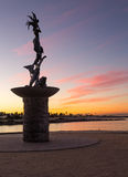 Mermaid statue entrance Ventura harbor. Mermaid statue playing flute by unknown artist at entrance to Ventura Harbor at sunrise stock photos