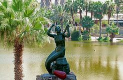 Mermaid Statue of Huaca China, Beautiful Princess in the Legend of this Oasis Town Who Gave Birth to the Lagoon, Huacachina, Peru. Mermaid Statue of Huaca China royalty free stock photography