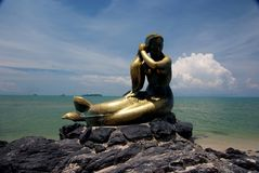 Mermaid Statue. Little mermaid statue sitting on a beach in Songkhla, Thailand. One of the provinces in Thailand stock photo