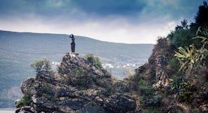 Mermaid statue in Montenegro. Mermaid statue on the rugged terrain in Montenegro stock photography
