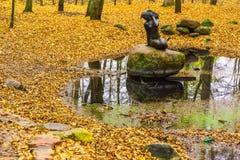 Mermaid Statue on Stone among Pond Royalty Free Stock Photo