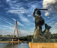Warsaw mermaid statue with blue cloudy sky in background royalty free stock photos