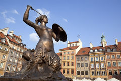 Mermaid statue in Warsaw oldtown, Poland. Warsaw's mermaid statue located in the center of Old Town square Royalty Free Stock Photo