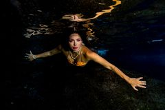 Mermaid swimming underwater in the deep blue sea Royalty Free Stock Photos