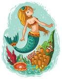 Mermaid swimming underwater in the ocean Royalty Free Stock Photos