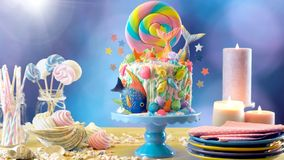 Mermaid theme candyland cake with glitter tails, shells and sea creatures. Mermaid theme candyland cake with colorful glitter tails, shells and sea creatures royalty free stock images