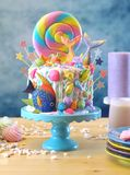 Mermaid theme candyland cake with glitter tails, shells and sea creatures. Mermaid theme candyland cake with colorful glitter tails, shells and sea creatures stock photography