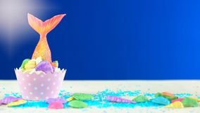 Mermaid theme cupcakes with colorful glitter tails, shells and sea creatures. Mermaid theme cupcakes with colorful glitter tails, shells and sea creatures royalty free stock photos