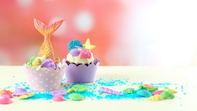 Mermaid theme cupcakes with colorful glitter tails, shells and sea creatures. Mermaid theme cupcakes with colorful glitter tails, shells and sea creatures stock images