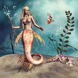 Mermaid with a trident. Fantasy mermaid holding a trident, with a fish and sea shells Royalty Free Stock Image