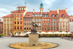 Mermaid of Warsaw at the Market Square, Poland. Statue of Syrenka, Mermaid of Warsaw, symbol of the city of Warsaw, at the Old Town Market Square, Poland stock photo