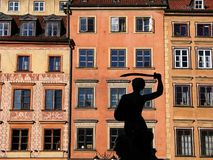Mermaid of Warsaw (Old town square). Houses at the old town square in the historical center of Warsaw, beautifully rebuilt after total destruction during WWII Royalty Free Stock Photos