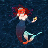 Mermaid in the water with a piece of gold. Royalty Free Stock Images
