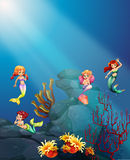 Mermaids swimming under the ocean Royalty Free Stock Photos
