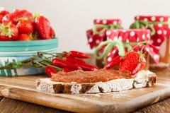 Mermelada de fresa con el chile Imagen de archivo libre de regalías