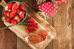 Mermelada de fresa con el chile Foto de archivo