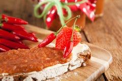 Mermelada de fresa con el chile Fotografía de archivo libre de regalías