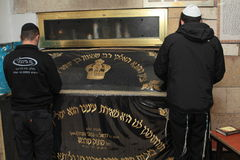 MERON, ISRAEL - December 29, 2015: Orthodox Jews pary in the tomb of Rabbi Shimon Bar Yochai, in Meron, Israel. Jewish Man wrapped. In tefillin And Talit And Stock Photo