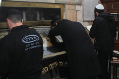 MERON, ISRAEL - December 29, 2015: Orthodox Jews pary in the tomb of Rabbi Shimon Bar Yochai, in Meron, Israel. Jewish Man wrapped. In tefillin And Talit And Stock Images