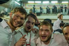 Annual hillula of Rabbi Shimon Bar Yochai, in Meron 2018. MERON, ISRAEL - MAY 03, 2018: Group of young Jewish orthodox men take part in the annual hillula of Stock Image