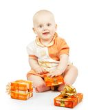 Merry baby with colorful gifts Stock Image